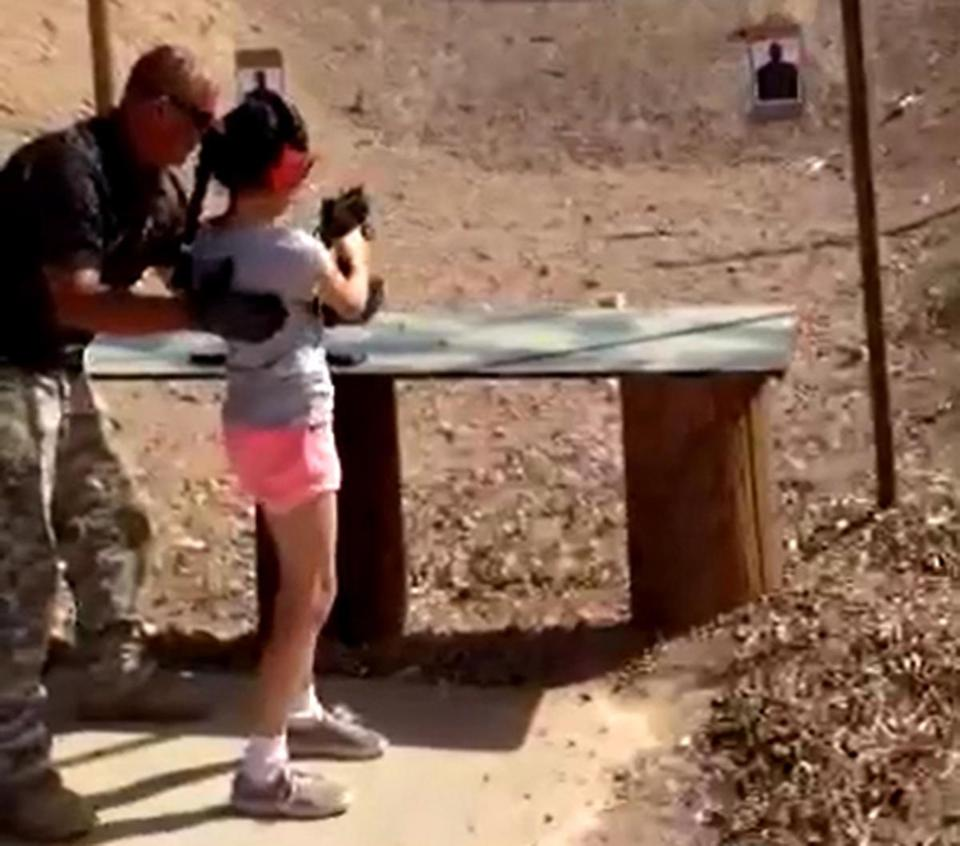 Shooting instructor Charles Vacca stood next to a 9-year-old girl at the Last Stop shooting range in White Hills, Arizona.